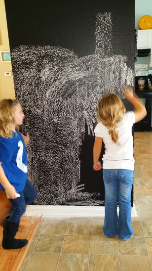 girls chalking wall
